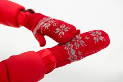 Female hand in red mittens with snow. - stock photo