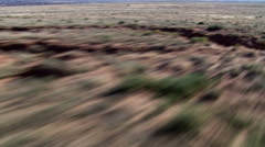 Fast, low flight over desert terrain Stock Footage