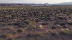 Low, fast flight over brushy mesa Stock Footage