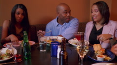 Right pan over couples at two booths in a restaurant Stock Footage