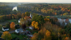 Flying over Maine village in autumn - stock footage