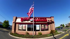 4K Wendys fast food restaurant, USA flag waving Stock Footage