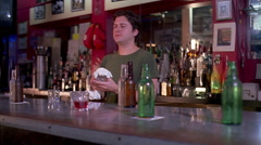 Bartender wiping glass in a sports bar Stock Footage