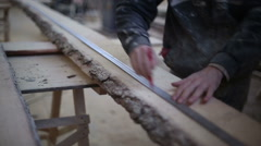 The carpenter draws a line for cutting boards Stock Footage