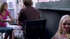 Left pan of patrons in an urban coffee bar Stock Footage