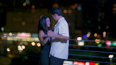 Couple dancing with multicolored lights in background Stock Footage