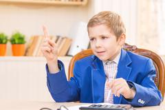 Little businessman boy giving orders Stock Photos