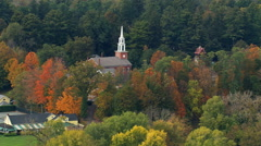 Flight past New England church in suburban community Stock Footage