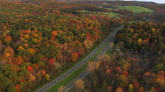 Flying above curving road through New York countryside - stock footage