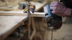 A carpenter polishes a piece of wood Stock Footage