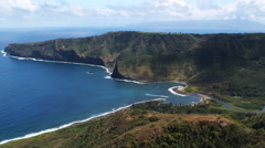 Over hilltop to orbit a cove on Molokai. Shot in 2010. Stock Footage
