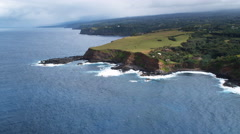 Orbiting green pastureland on sea cliffs along Maui's north shore. Shot in 2010. Stock Footage