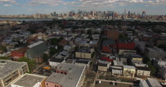 Northern NJ Flyover Red Top Houses & Buildings With NyC Skyline In Distance Stock Footage