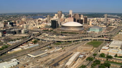 Flying past Superdome toward downtown New Orleans. Shot in 2007. - stock footage