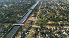 Orbiting canal and New Orleans residential areas. Shot in 2007. Arkistovideo