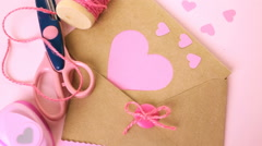 Hand crafted Valentines Day card from recycled paper. Stock Footage