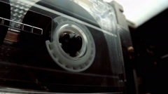 The cassette is played in the tape drive recorder of vintage audio equipment - stock footage