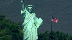 Close flight past Statue of Liberty to zoom-out. Shot in 2003. Stock Footage
