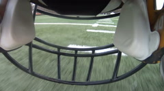 Point of view from football helmet running down field Stock Footage