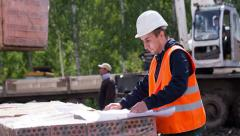 Engineer delves into the drawings or blueprint. Stock Footage