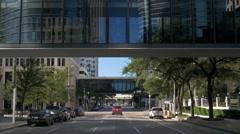 driving under overhead walkways in downtown houston - stock footage