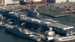 Flight over Hudson River and USS Intrepid for view of Manhattan. Shot in 2003. Stock Footage