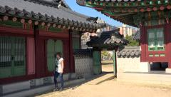 Tourist on the territory of Gyeongbok Palace. Seoul, South Korea. - stock footage