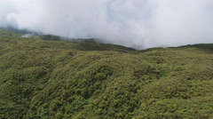 Over misty forested hills of Molokai Stock Footage