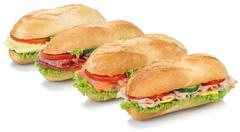 Stock Photo of Collection of sub sandwiches baguettes with salami, salmon, fish, ham and che