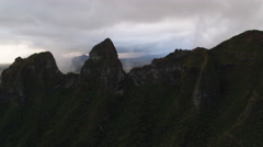 Stock Video Footage of Through a gap in a rocky ridge to a view of Mamalahoa Forest, Oahu