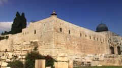 Al Aqsa Mosque dome and courtyard from outside southwest wall of Jerusalem - stock footage
