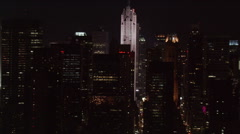 Night flight looking down between Manhattan skyscrapers. Shot in 2005. Stock Footage
