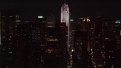 Night flight looking down between Manhattan skyscrapers. Shot in 2005. Stock Footage