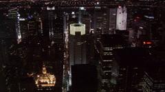 Night flight over midtown Manhattan skyscrapers. Shot in 2005. Stock Footage