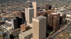 Slow orbit past skyscrapers of downtown Phoenix. Shot in 2007. - stock footage
