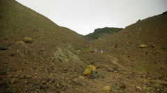 Hiker walks far in the distance - stock footage