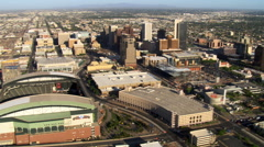 Flight past downtown Phoenix and Chase Field with roof retracted. Shot in 2007. - stock footage