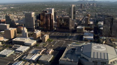 Flight past downtown Phoenix with wide view to mountains. Shot in 2007. - stock footage