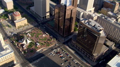 Orbit of lower buildings in downtown Phoenix with view down to park. Shot in Stock Footage