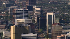 Flight past downtown Phoenix with wide view of layered skyscrapers. Shot in - stock footage