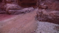 Overhead view of horse and buggy passing through the Siq at Petra, Jordan Stock Footage