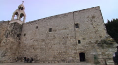Left pan over courtyard of the Church of the Nativity in Bethlehem Stock Footage