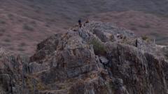 Close flight past Squaw Peak (Piestewa Peak) near Phoenix, people on ridge top. Stock Footage