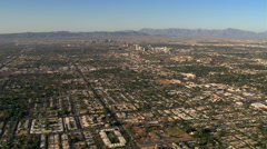 Wide approach toward downtown Phoenix over outlying areas. Shot in 2007. - stock footage