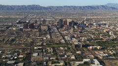 Wide orbit of Phoenix with downtown in mid-frame, mountains in background. Shot Stock Footage