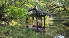 Pavilion and pond in the Huwon (Secret Garden) of the Changdeokgung Palace Stock Footage