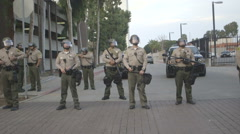 Riot Police block road at a Protest Stock Footage