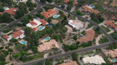 Mid-level flight over upscale Scottsdale neighborhood. Shot in 2007. Stock Footage