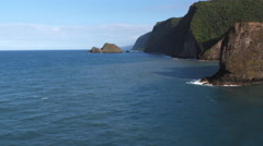 Past a rocky point and along cliffs in The Valleys area of Hawaiian coast. Shot Stock Footage