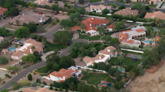 Flight over wealthy Scottsdale residential area bordering a golf course. Shot in Stock Footage